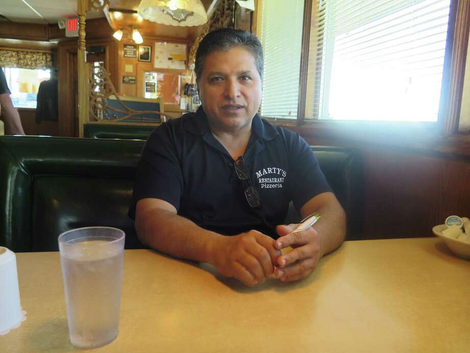 Gonzalo Perez, 50, owner of the House of Castlewood, talks at his restaurant on Wednesday, Oct. 4, 2017, in Sturtevant, Wis., about the potential economic benefit from Foxconn building a manufacturing plant nearby. The Taiwan-based company announced that the location for the plant would be in Mount Pleasant, just across the highway from Perez's restaurant. (AP Photo/Ivan Moreno) Photo: Ivan Moreno, STF / Copyright 2017 The Associated Press. All rights reserved.
