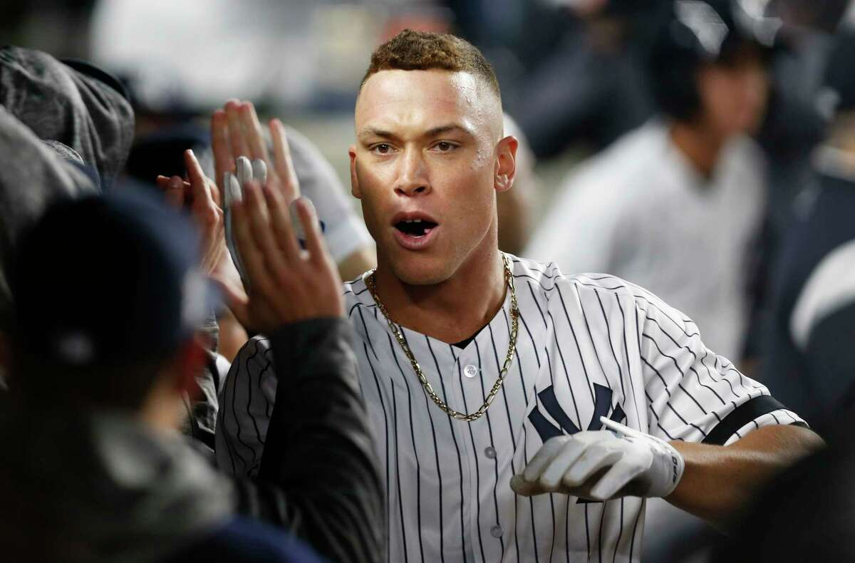 New York Yankees' Aaron Judge celebrates in the dugout with teammates after hitting a two-run home run during the fourth inning of the American League wild-card playoff baseball game against the Minnesota Twins in New York, Tuesday, Oct. 3, 2017. (AP Photo/Kathy Willens) ORG XMIT: NYY129