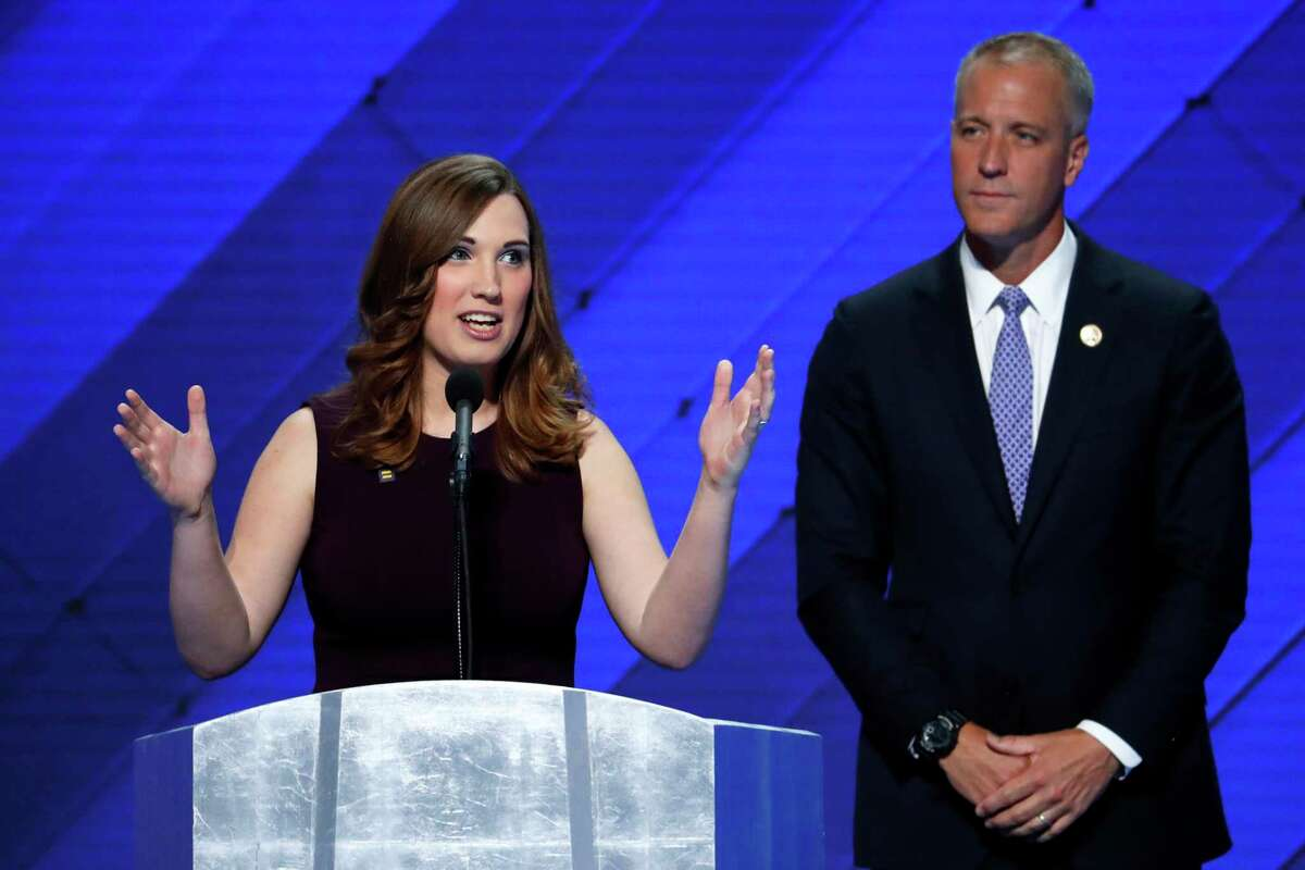 FILE - In this July 28, 2016 file photo, LGBT rights activist Sarah McBride speaks as Rep. Sean Patrick Maloney, D-NY, Co-Chair of the Congressional LGBT Equality Caucus listens during the final day of the Democratic National Convention in Philadelphia. Former vice president Joe Biden is writing the foreword to a memoir by transgender activist McBride, who made history when she addressed the Democratic National Convention last year. (AP Photo/J. Scott Applewhite, File) ORG XMIT: NYSP601