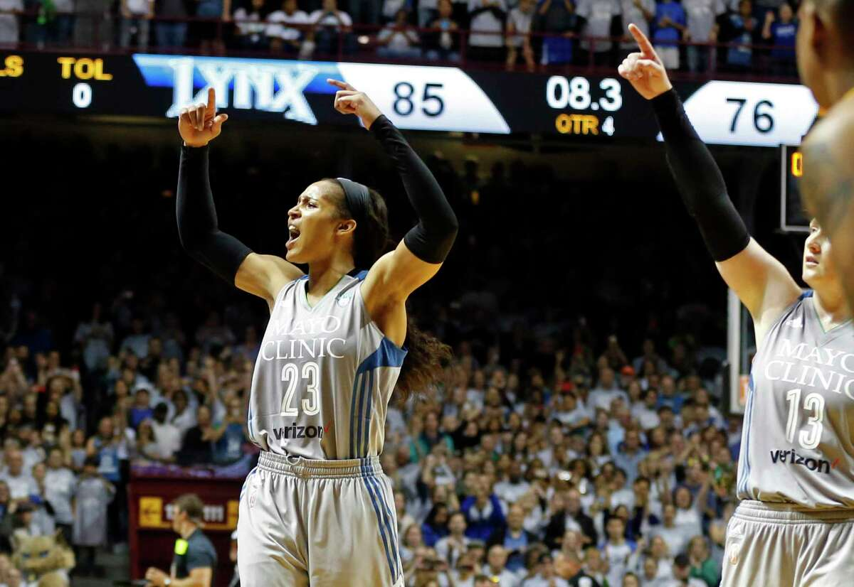 Minnesota Lynx's Maya Moore cheers on the crowd with seconds left against the Los Angeles Sparks Wednesday, Oct. 4, 2017, in Minneapolis. The Lynx won the WNBA Championship 85-76. Moore scored 18 points.