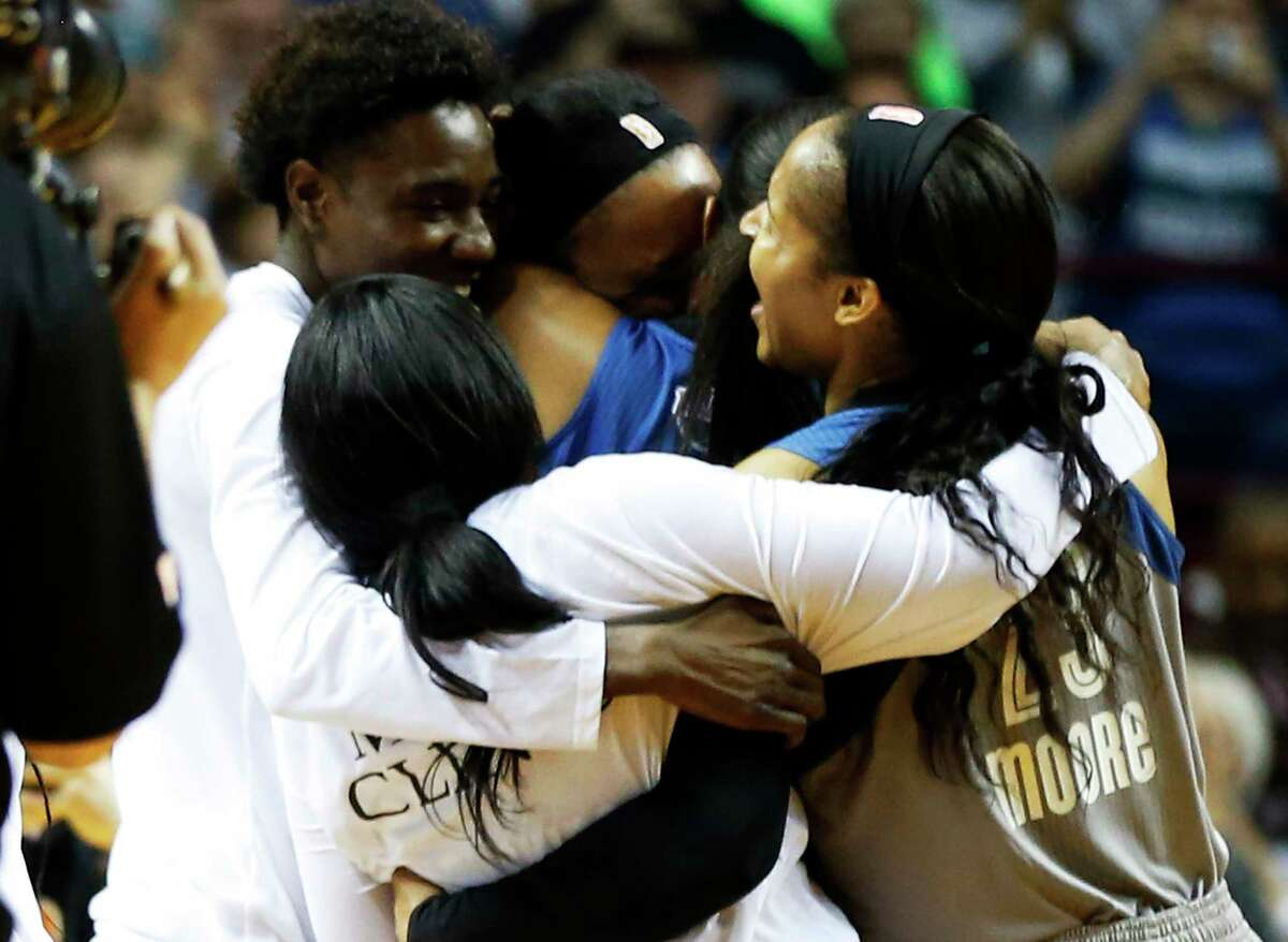 Minnesota Lynx's Maya Moore, right, and teammates celebrate after they won the WNBA Finals Championship Wednesday, Oct. 4, 2017, in Minneapolis with an 85-76 win over the Los Angeles Sparks. Moore scored 18 points.