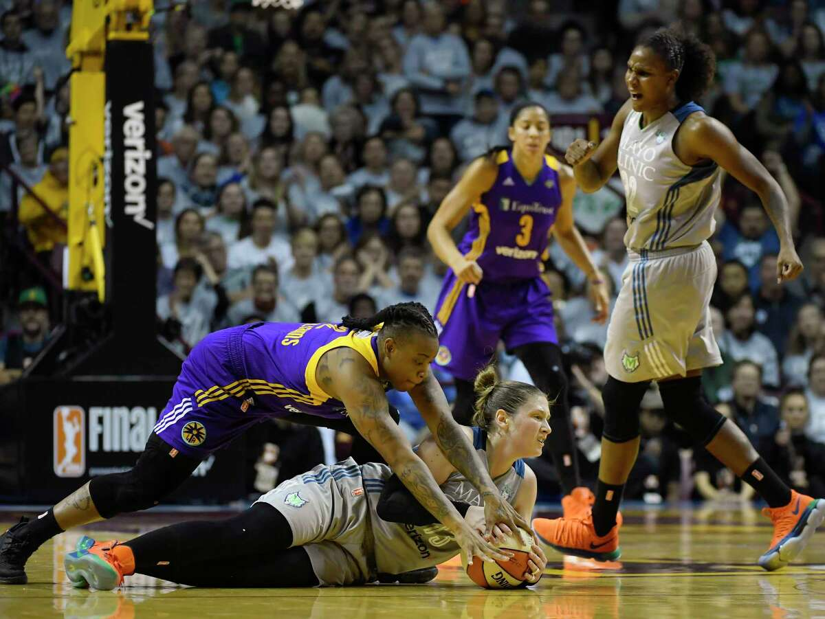 Minnesota Lynx guard Lindsay Whalen is fouled by Los Angeles Sparks guard Riquna Williams during the first half of Game 5 of the WNBA Finals, Wednesday, Oct. 4, 2017 in Minneapolis. (Aaron Lavinsky/Star Tribune via AP)