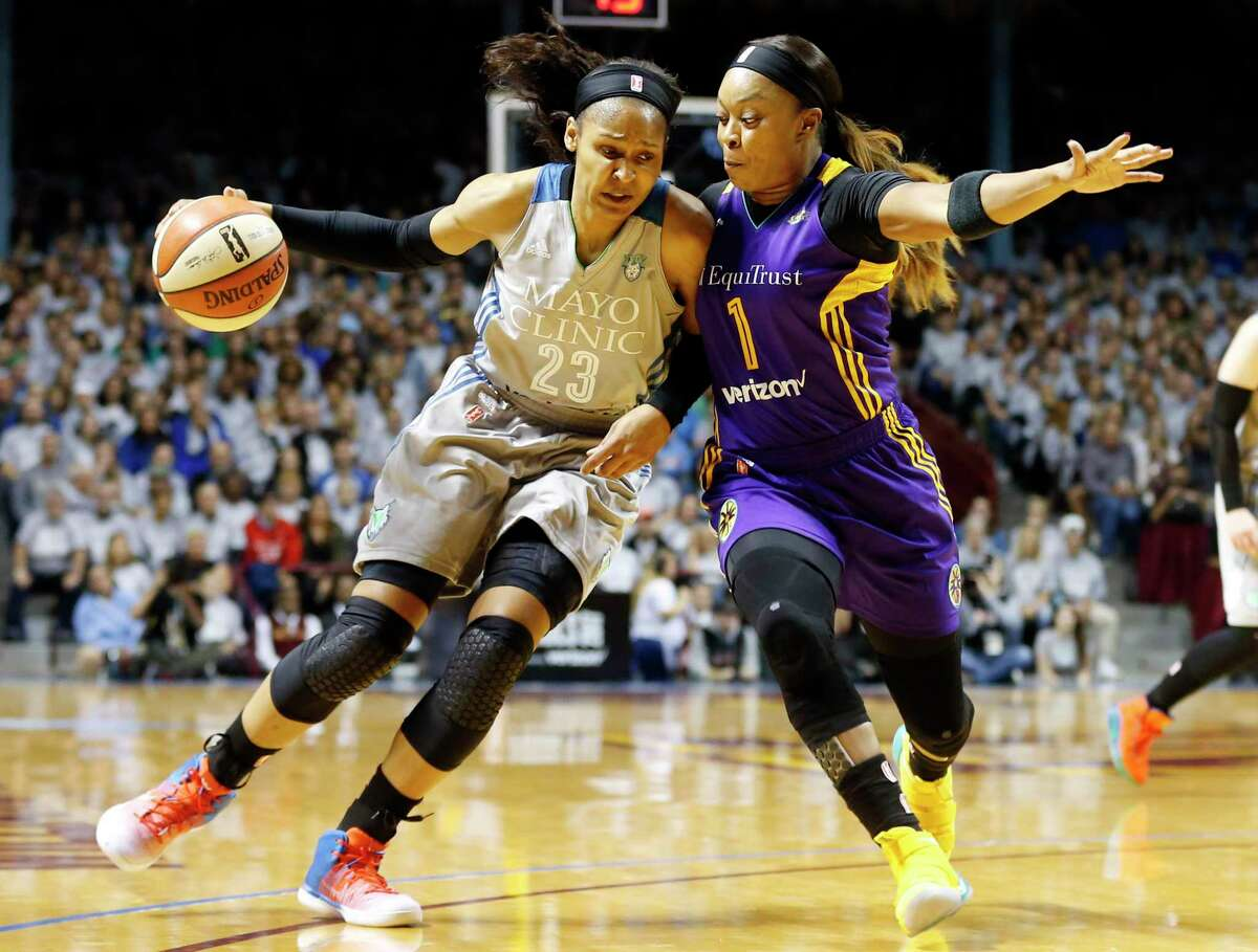 Minnesota Lynx's Maya Moore, left, drives around Los Angeles Sparks' Odyssey Sims in the first half during Game 5 of the WNBA Finals Wednesday, Oct. 4, 2017, in Minneapolis. (AP Photo, Jim Mone) ORG XMIT: MNJM102