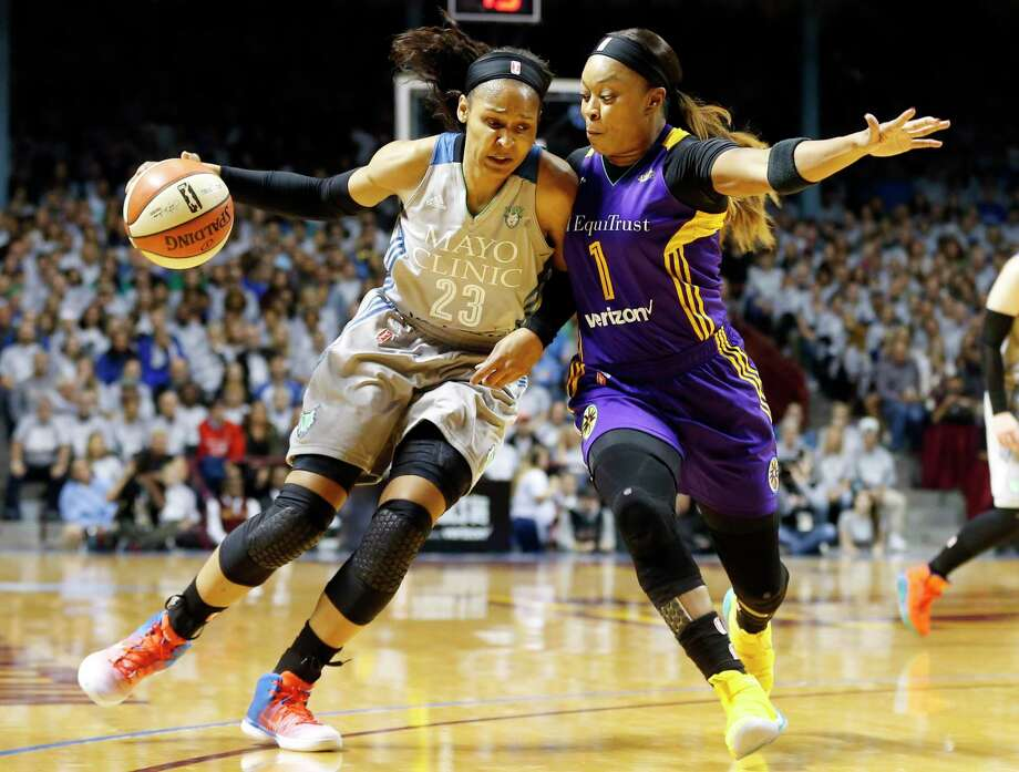 Minnesota Lynx's Maya Moore, left, drives around Los Angeles Sparks' Odyssey Sims in the first half during Game 5 of the WNBA Finals Wednesday, Oct. 4, 2017, in Minneapolis. (AP Photo, Jim Mone) ORG XMIT: MNJM102 Photo: Jim Mone / Copyright 2017 The Associated Press. All rights reserved.