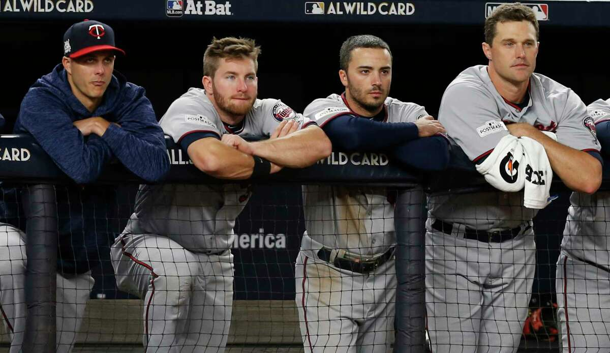 Minnesota Twins players watch during the closing innings of their 8-4 loss in an American League wild-card playoff baseball game against the New York Yankees in New York, Tuesday, Oct. 3, 2017. (AP Photo/Kathy Willens) ORG XMIT: NYY148