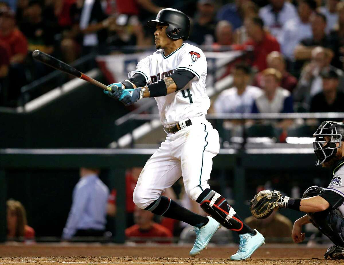 Arizona Diamondbacks' Ketel Marte follows through on a triple against the Colorado Rockies during the fourth inning of the National League wild-card playoff baseball game, Wednesday, Oct. 4, 2017, in Phoenix. (AP Photo/Ross D. Franklin) ORG XMIT: AZMY136