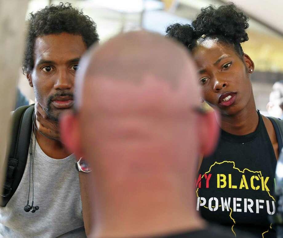 Jarrett Wright, left, and a fellow Cal student, right, who preferred to not be identified, listen to Patriot Prayer's Kyle Broussard, center, explains his stance on the Black Lives Matter movement at Sproul Plaza on the University of California at Berkeley campus on Wednesday, September 27, 2017. Photo: Scott Strazzante / The Chronicle / San Francisco Chronicle