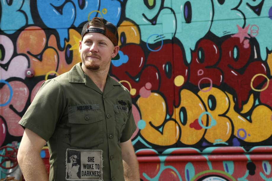 "Houston Astros relief pitcher Chris Devenski stands next to one of his favorite grafitti walls, created by artist Fernando Carlo Jr. a.k.a. ""Cope 2"", at 1501 St. Emanuel, Tuesday, Sept. 19, 2017, in Houston.  ( Karen Warren / Houston Chronicle ) Photo: Karen Warren/Houston Chronicle"