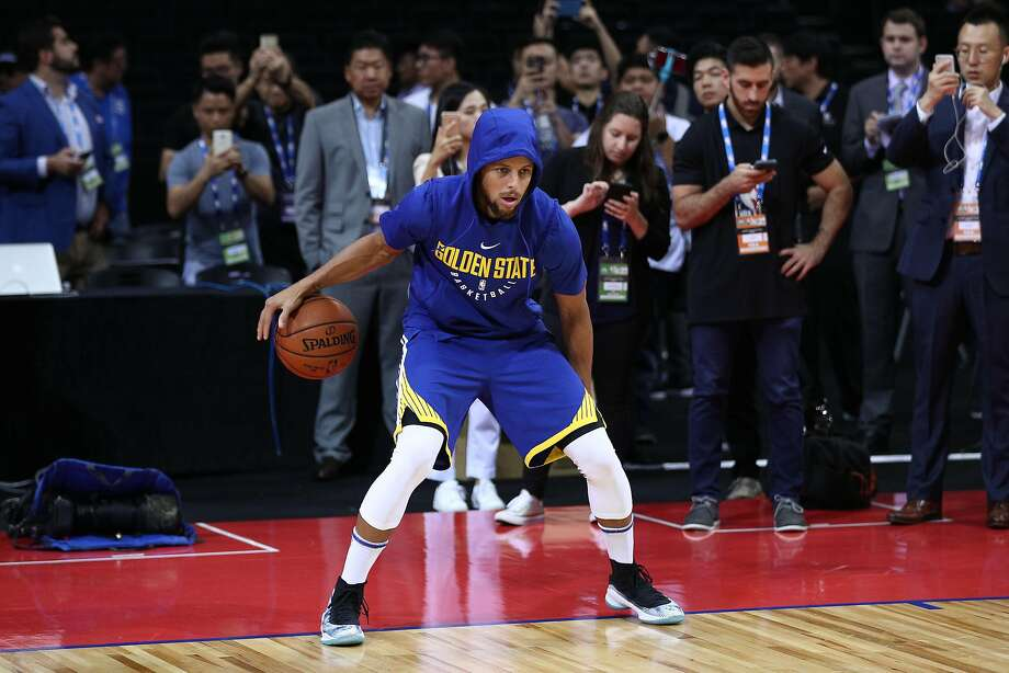 Stephen Curry of the Golden State Warriors warms up before the game between the Minnesota Timberwolves and the Golden State Warriors as part of 2017 NBA Global Games China at Universidade Center on October 5, 2017 in Shenzhen, China. Photo: Zhong Zhi, Getty Images