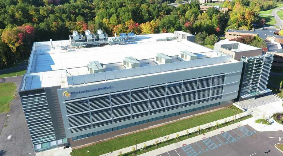 SUNY Poly's Quad-C building in Utica is home to Danfoss Silicon Power, which is planning to employ 300 people as it ramps up operations to make power modules used in cars, solar and wind power technologies and industrial devices. Photo: SUNY Polytechnic Institute