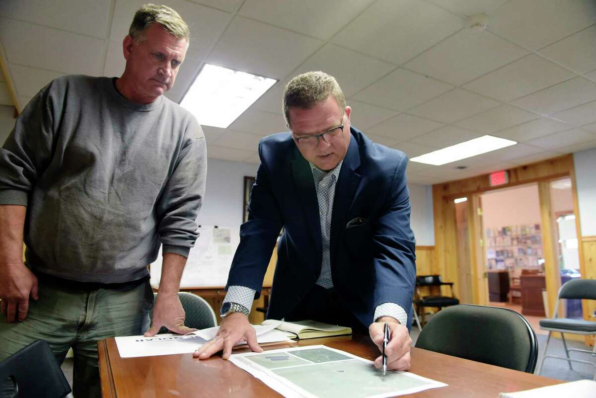 Daryl Legg, left, supervisor of the Town of Hunter, and Mark Richardson, president of Solitude Solar, look over maps that pertain to a proposed solar project in the town on Monday, Oct. 2, 2017, in Hunter, N.Y. (Paul Buckowski / Times Union)