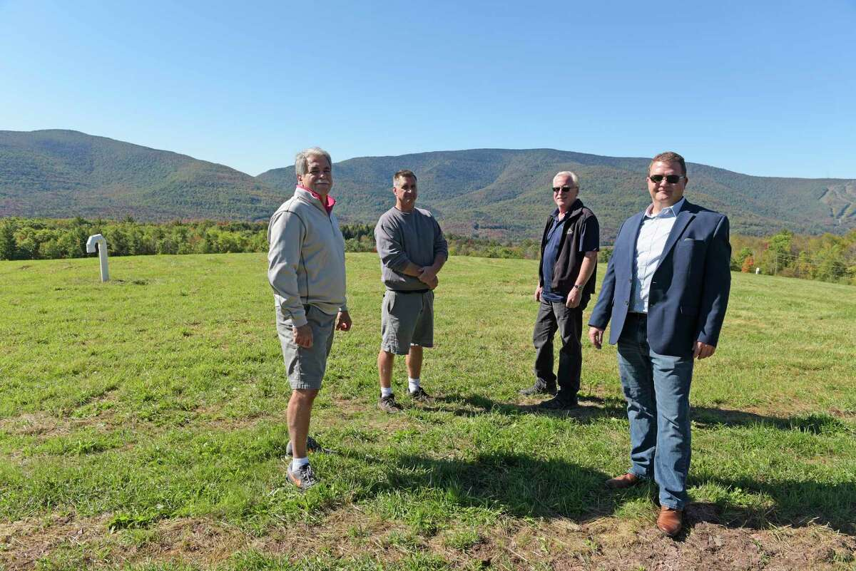 From left to right, Dolph Semenza, Town of Hunter councilman, Daryl Legg, supervisor of the Town of Hunter, David Kukle, Town of Hunter councilman and Mark Richardson, president of Solitude Solar, stand on a capped section of the landfill at the Town of Hunter on Monday, Oct. 2, 2017, in Hunter, N.Y. (Paul Buckowski / Times Union)