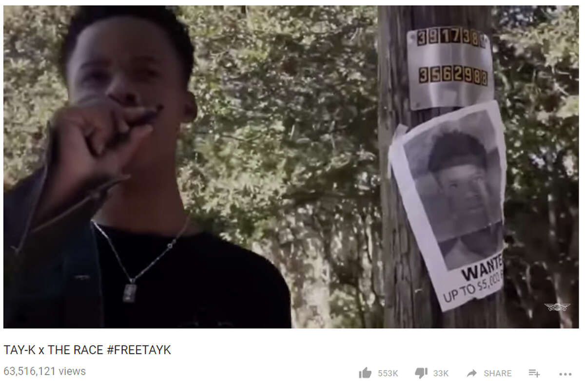 """Tay-K 47 posed with his own wanted poster in a music video for his song """"The Race,"""" which has reached over 63 million views as he sat in jail on murder charges in San Antonio."""