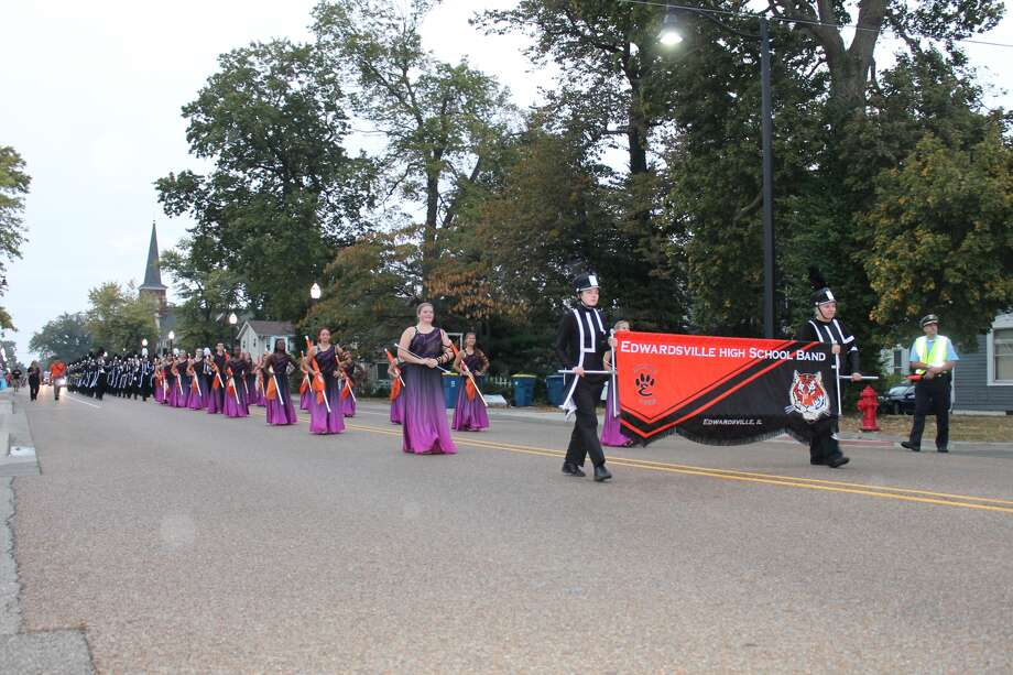 "Despite a brief shower, the Edwardsville High School Homecoming Parade went on as scheduled Wednesday night. This year's theme is, ""An Evening in Egypt."" Numerous sports teams and clubs were represented along with area youngsters from different organizations. Above, the Marching Tiger Band heads down Main Street. On Friday, the football Tigers will host Belleville East at 7 p.m. in the Homecoming game. On Saturday, coronation is scheduled at 7 p.m. in Lucco-Jackson Gymnasium at EHS with the dance to follow. Coronation is open to the public and tickets are $5. Photo: Bill Tucker"