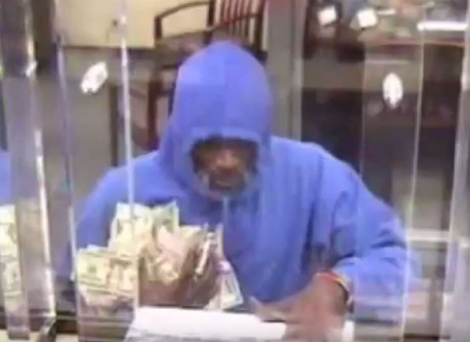 Two suspects are wanted for robbing the Amegy Bank at 6602 Fannin on Friday, Aug. 25, 2017. The two got away with a large amount of cash, Houston Police said in a release. Photo: Houston Police Department Robbery Division