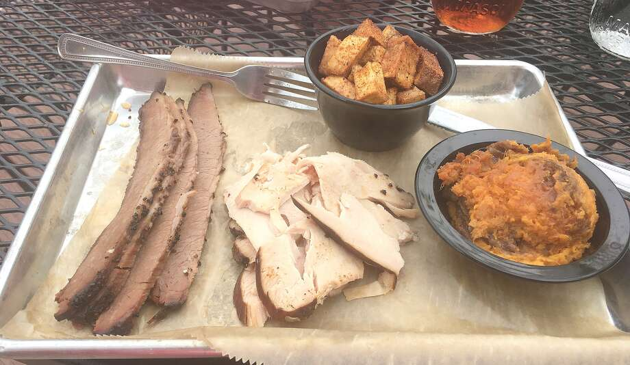 Beef brisket and smoked turkey with sides of sweet potato casserole and fried potatoes and onions. Photo: Bill Roseberry • Of The Edge