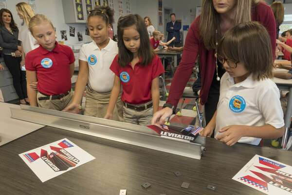 Washington Academy fourth graders, try the new levitating train that was donated 10/05/17 during the kick-off of Fuel Your Schools, a fundraiser with Kent Kwik, Chevron and MISD, where area Kent Kwik Chevron stations will donate a portion of gas sales to area STEM programs in MISD and ECISD. Tim Fischer/Reporter-Telegram