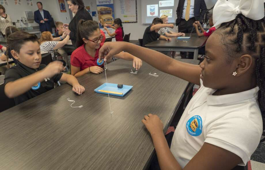 Tiana Carter, Cisco Rodriguez, Sienna Rodriguez and other Washington Academy fourth graders, try to levitate a paperclip with magnets 10/05/17 during the kick-off of Fuel Your Schools, a fundraiser with Kent Kwik, Chevron and MISD, where area Kent Kwik Chevron stations will donate a portion of gas sales to area STEM programs in MISD and ECISD. Tim Fischer/Reporter-Telegram Photo: Tim Fischer/Midland Reporter-Telegram