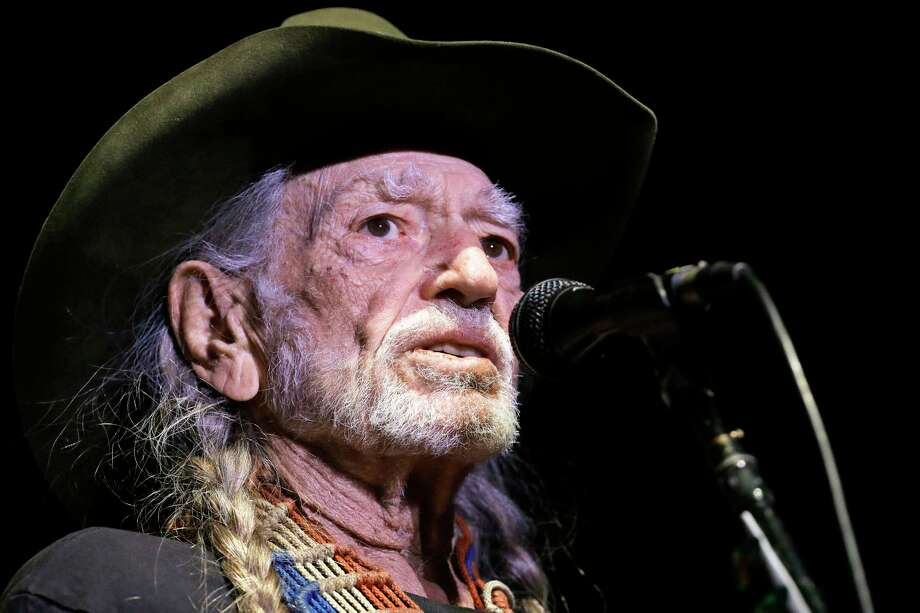 """FILE - In this Jan. 7, 2017, file photo, Willie Nelson performs in Nashville, Tenn. Organizers of the """"Harvey Can't Mess With Texas"""" benefit concert announced on Wednesday, Sept. 13, that Nelson, Bonnie Raitt, Paul Simon and James Taylor are among the stars headlining the four-hour show scheduled for Sept. 22 in Austin that will raise money for victims of Hurricane Harvey. (AP Photo/Mark Humphrey, File) Photo: Mark Humphrey, STF / Copyright 2017 The Associated Press. All rights reserved."""