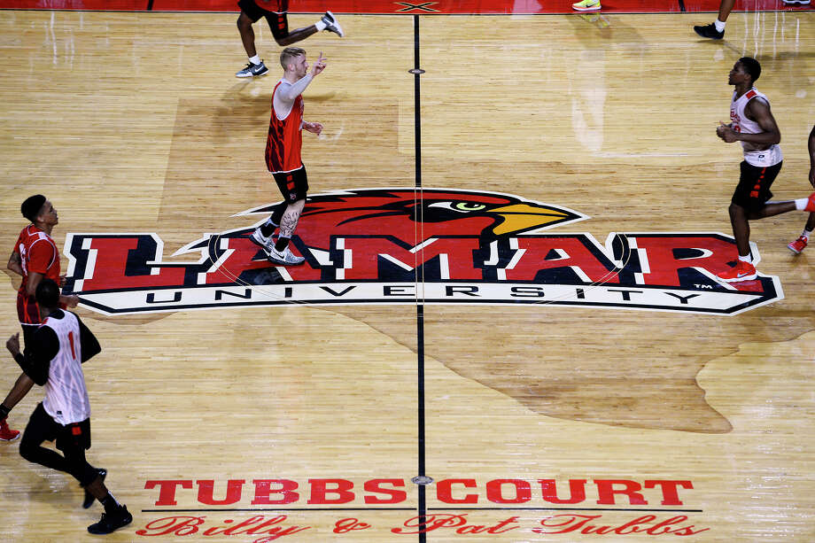 Lamar basketball players run across mid-court during practice on Thursday.  Photo taken Thursday 8/10/17 Ryan Pelham/The Enterprise Photo: Ryan Pelham / ©2017 The Beaumont Enterprise/Ryan Pelham