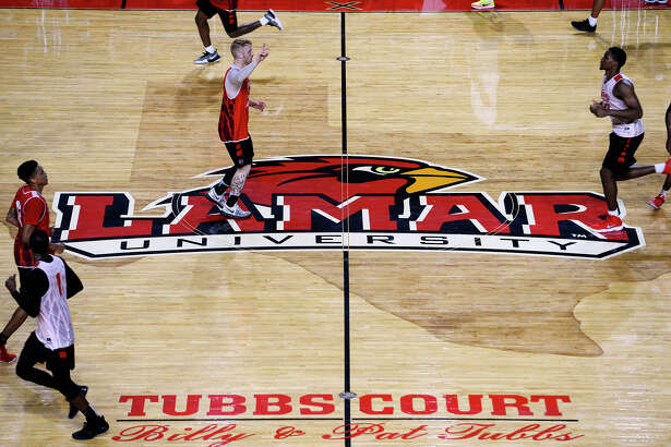 Lamar basketball players run across mid-court during practice on Thursday.  Photo taken Thursday 8/10/17 Ryan Pelham/The Enterprise