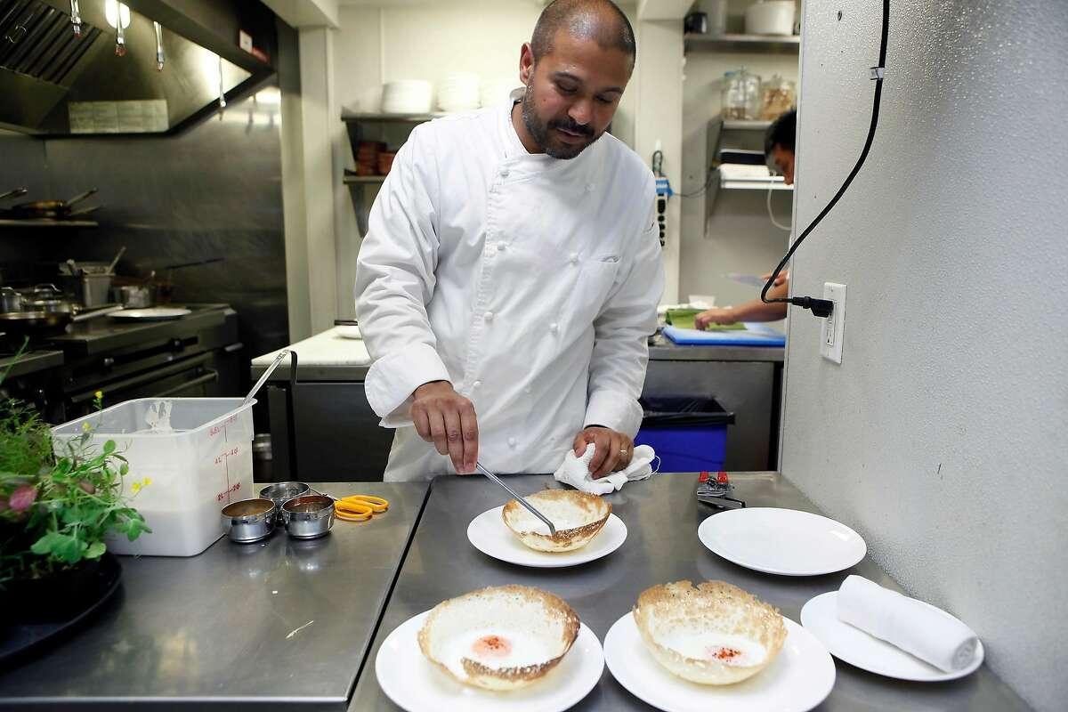 Chef Brian Fernando prepares the Egg Hopper, a South Indian/Sri Lankan crepe, at 1601 Bar & Kitchen in San Francisco, CA, Wednesday June 11, 2014.