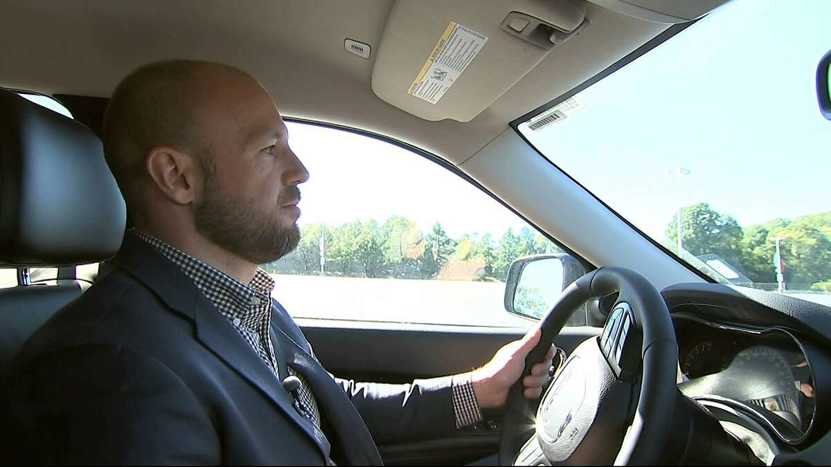 In this image from video, Jake Nelson, AAA's director for traffic safety advocacy and research drives one of the test vehicles used in the study in Washington, Wednesday, Oct. 4, 2017. Infotainment technology automakers are cramming into the dashboard of new vehicles is making drivers take their eyes off the road and hands off the wheel for dangerously long periods of time, a study being released by AAA on Oct. 5 says. (AP Photo/Bill Gorman)