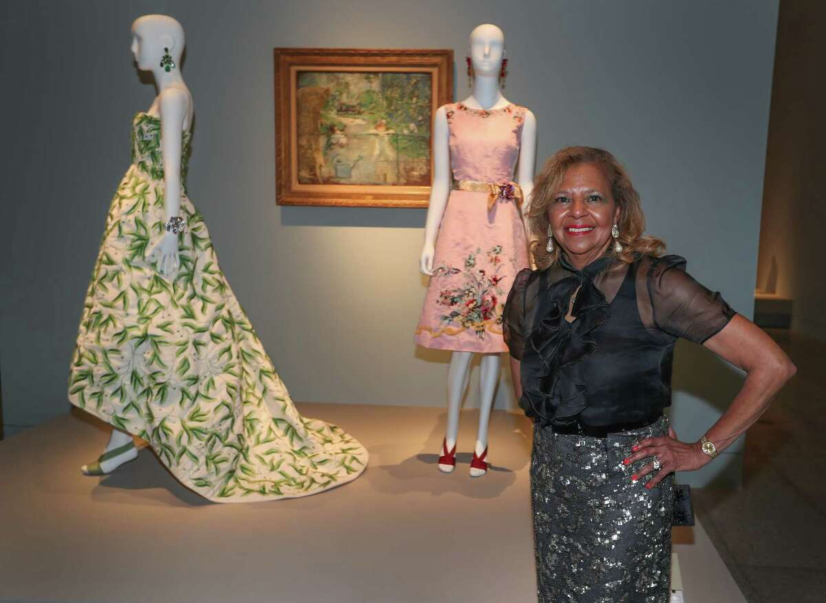 Yvonne Cormier (with the 2012 resort collection pink silk faille and silk embroidered dress she loaned to the exhibition) at the Museum of Fine Arts, Houston exhibition