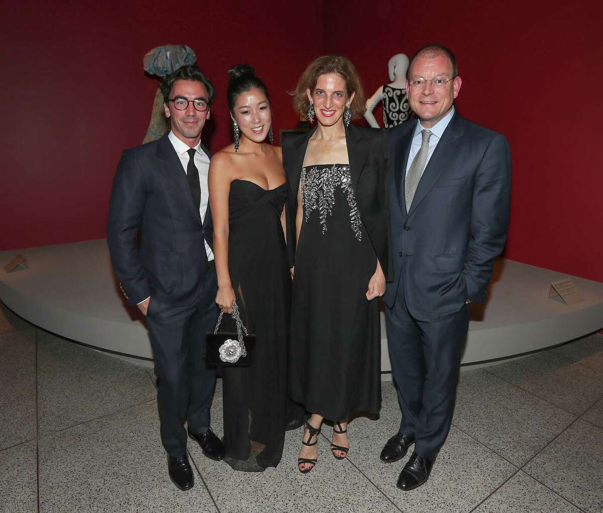 Oscar de la Renta designers Fernando Garcia and Laura Kim with de la Renta?•s stepdaughter Eliza Bolen and her husband, Alex Bolen, CEO of Oscar de la Renta LLC at the Museum of Fine Arts, Houston exhibition