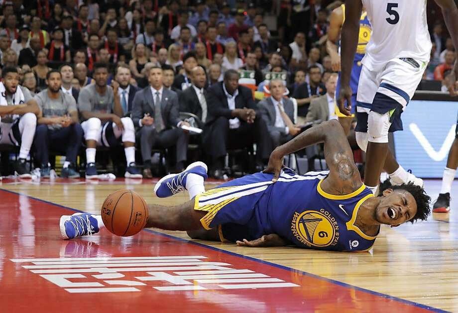 The Warriors' Nick Young is in pain after bruising his right hip in a hard spill late in Thursday's exhibition loss to the Timberwolves in Shenzhen. Photo: Kin Cheung, Associated Press