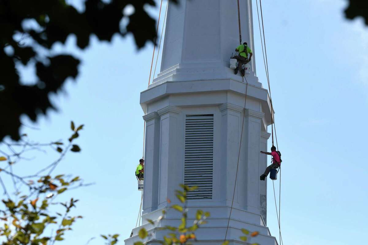 Workers from Valley Restorationapply a new coat of paint to the former First Baptist Church of Troy on Thursday, Oct. 5, 2017, in Troy, N.Y. The building was sold to theTau Nu chapter ofPhi Gamma Delta in 2014. (Will Waldron/Times Union)