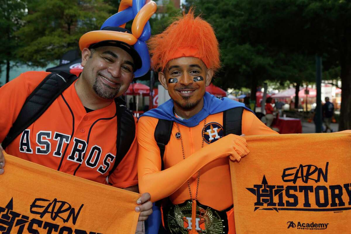 People are shown at the Postseason Street Fest outside Minute Maid Park before the Astros and Red Sox play Game 1 of the American League Division Series Thursday, Oct 5, 2017.