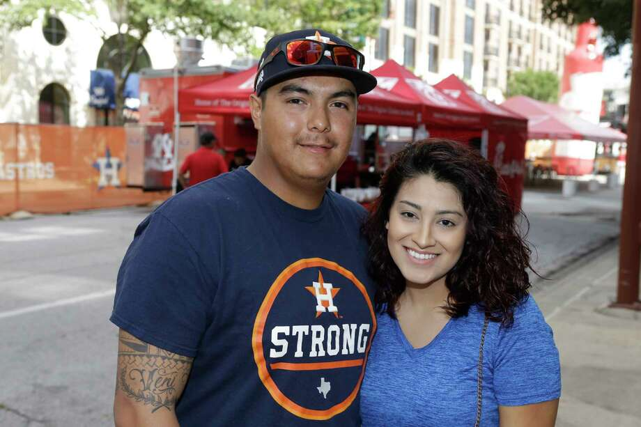 People are shown at the Postseason Street Fest outside Minute Maid Park before the Astros and Red Sox play Game 1 of the American League Division Series Thursday, Oct 5, 2017. Photo: Melissa Phillip, Houston Chronicle / Houston Chronicle 2017