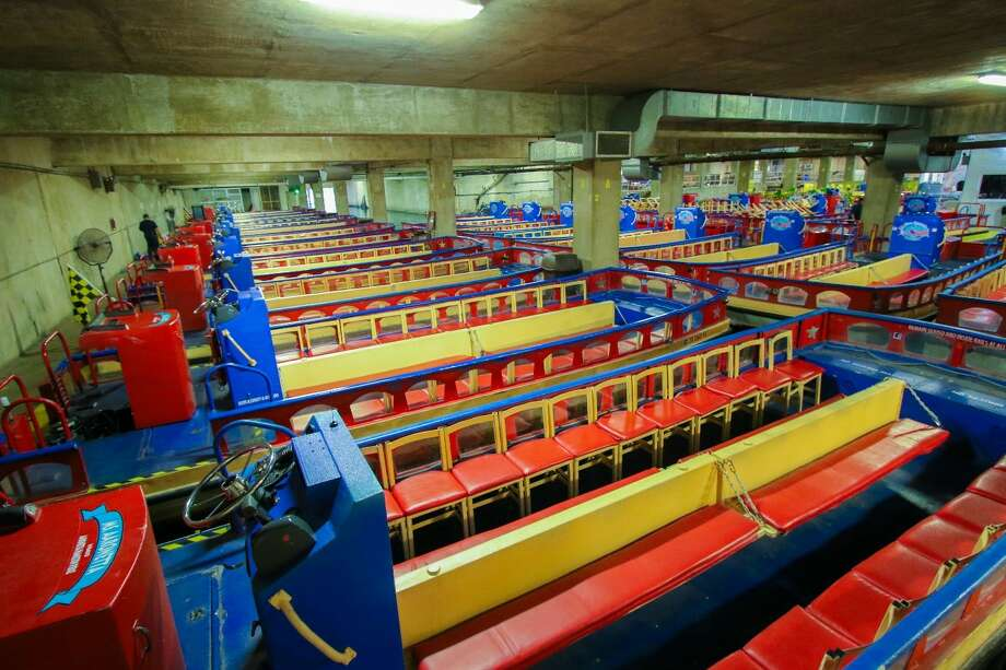 Dozens of old river barges now sit in a storage facility 8 miles North of downtown San Antonio where they await new buyers. Photo: Courtesy/Rio San Antonio Cruises