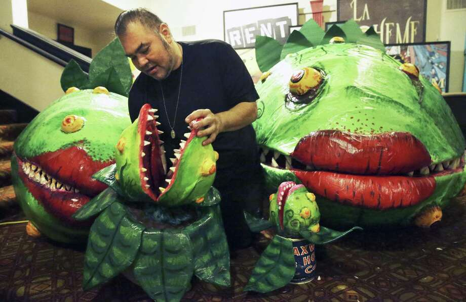 """Prop designer Richard Solis used everyday items — such as masking tape, H-E-B bags and scraps of plastic — to build the puppets for the Woodlawn Theatre's staging of """"Little Shop of Horrors."""" Photo: Tom Reel /San Antonio Express-News / 2017 SAN ANTONIO EXPRESS-NEWS"""