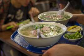 Pho being brought to tables at Turtle Tower in San Francisco, Calif., on Saturday, August 3rd, 2013.