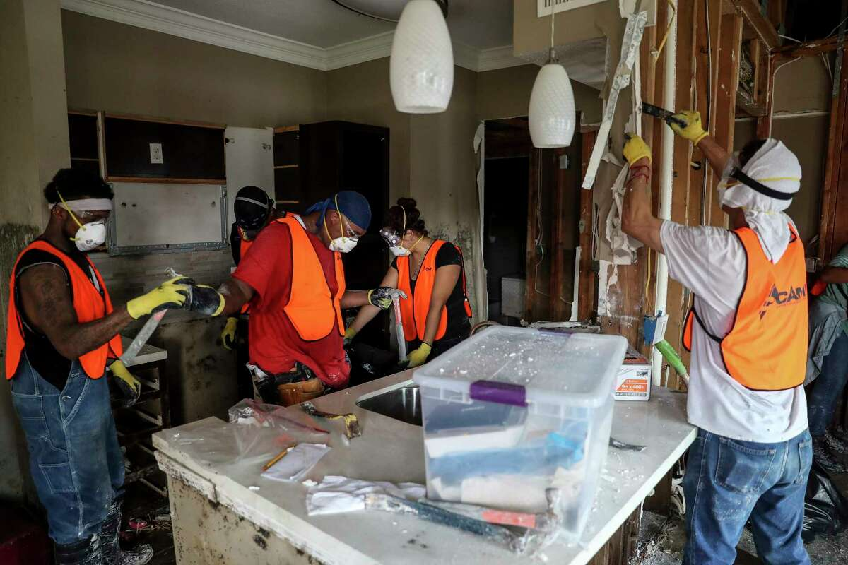 CAMP Construction Services contractors work to demo units at The Grand on Memorial which flooded during Hurricane Harvey Wednesday, Oct. 4, 2017 in Houston. ( Michael Ciaglo / Houston Chronicle)