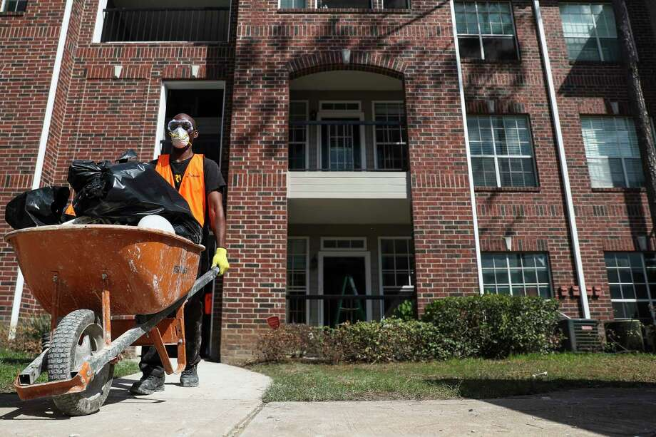 Can Houston beat nature? In this photo: A contractor removes debris from apartments that flooded during Harvey. Photo: Michael Ciaglo, Houston Chronicle / Michael Ciaglo