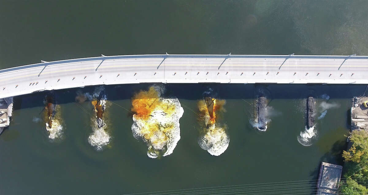 Keep clicking for photos of structures we've blown up or torn down in the Capital Region. Drone photos in sequence of the implosion of the piers of the former Cohoes Waterford Bridge Thursday morning October 5, 2017. (Kevin P. Coughlin/Office of Governor Andrew M. Cuomo)