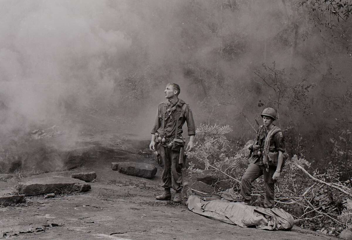 """US Service Member, standing in smoke, shocked. featured in the film """"The Vietnam War"""" by Ken Burns and Lynn Novick airing on PBS"""