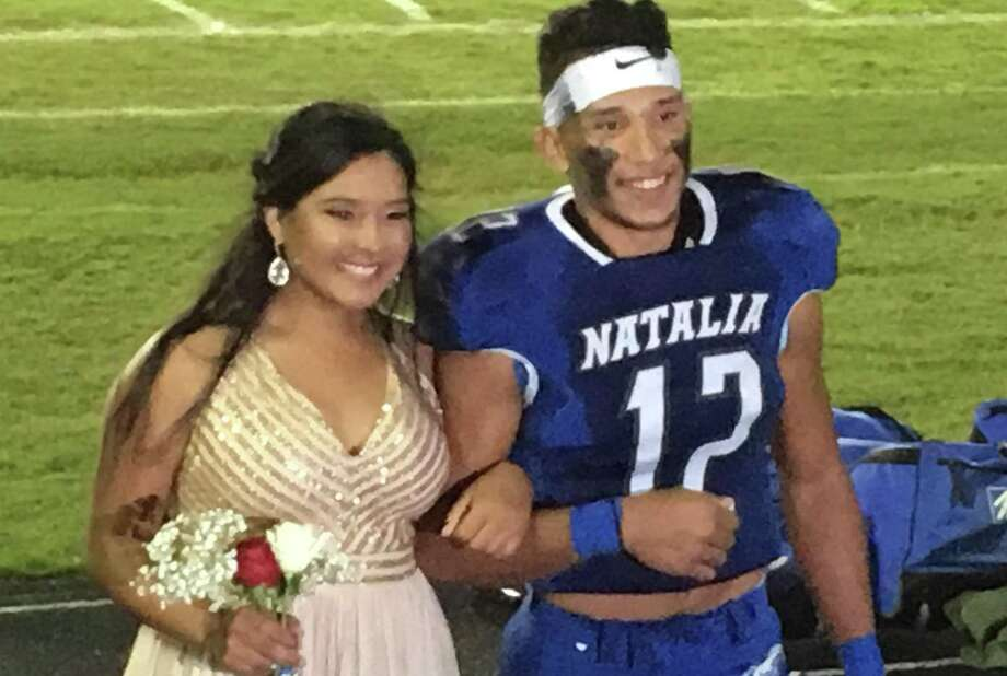 Ray Rizo, posing with queen Trinity Vera, was named homecoming king at halftime last week. Photo: Roy Bragg /San Antonio Express-News