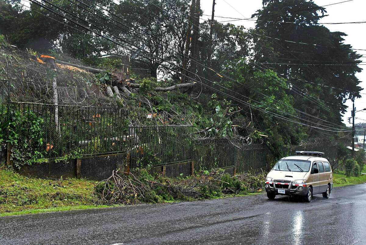 A van drives past fallen trees, blown down by strong winds and rainfall caused by tropical storm Nate in Cartago, 25 kilometres East of San Jose on October 5, 2017. Costa Rica is under a National Emergency decree due to heavy rains and winds that already left two dead and 6 dissapeared, while several roads and bridges were damaged, and rockslides blocked access to some villages. / AFP PHOTO / EzequielBECERRAEZEQUIELBECERRA/AFP/Getty Images