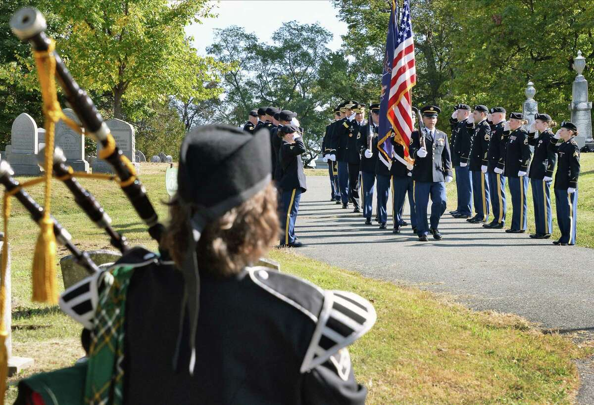 Piper Michele Lyons Polito, left, plays as a NY Army National Guard Color Guard takes up their position during a gravesite ceremony for Chester A. Arthur, our 21st president, at Albany Rural Cemetery on the anniversary of his birth Thursday Oct. 5, 2017 in Menands, NY. (John Carl D'Annibale / Times Union)