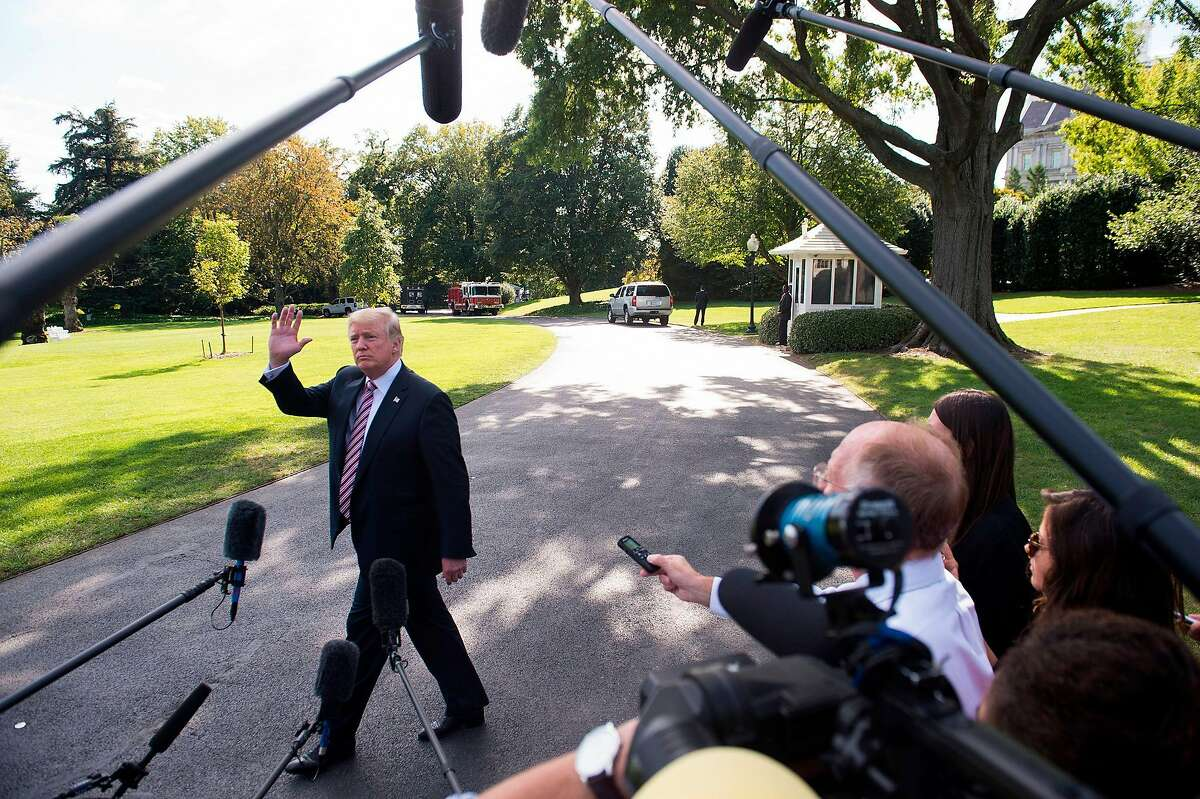 (FILES) This file photo taken on September 29, 2017 shows US President Donald Trump speaking to the media prior to boarding Marine One and departing from the South Lawn of the White House in Washington, DC. In the latest in a series of broadsides against the media, US President Donald Trump suggested on October 5, 2017 that lawmakers investigate journalists for their work.