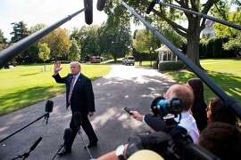 "(FILES) This file photo taken on September 29, 2017 shows US President Donald Trump speaking to the media prior to boarding Marine One and departing from the South Lawn of the White House in Washington, DC. In the latest in a series of broadsides against the media, US President Donald Trump suggested on October 5, 2017 that lawmakers investigate journalists for their work.""Why Isn't the Senate Intel Committee looking into the Fake News Networks in OUR country to see why so much of our news is just made up-FAKE!"" Trump said in a tweet.That was a reference to a Senate panel which on Wednesday said it was still investigating collusion between Trump's 2016 presidential campaign and Moscow.  / AFP PHOTO / SAUL LOEBSAUL LOEB/AFP/Getty Images"
