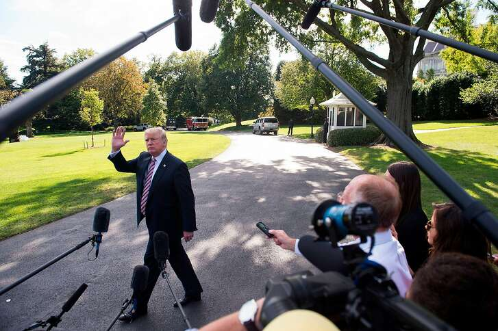 """(FILES) This file photo taken on September 29, 2017 shows US President Donald Trump speaking to the media prior to boarding Marine One and departing from the South Lawn of the White House in Washington, DC. In the latest in a series of broadsides against the media, US President Donald Trump suggested on October 5, 2017 that lawmakers investigate journalists for their work.""""Why Isn't the Senate Intel Committee looking into the Fake News Networks in OUR country to see why so much of our news is just made up-FAKE!"""" Trump said in a tweet.That was a reference to a Senate panel which on Wednesday said it was still investigating collusion between Trump's 2016 presidential campaign and Moscow.  / AFP PHOTO / SAUL LOEBSAUL LOEB/AFP/Getty Images"""