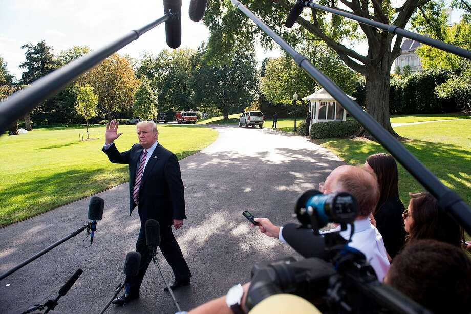 """(FILES) This file photo taken on September 29, 2017 shows US President Donald Trump speaking to the media prior to boarding Marine One and departing from the South Lawn of the White House in Washington, DC. In the latest in a series of broadsides against the media, US President Donald Trump suggested on October 5, 2017 that lawmakers investigate journalists for their work.""""Why Isn't the Senate Intel Committee looking into the Fake News Networks in OUR country to see why so much of our news is just made up-FAKE!"""" Trump said in a tweet.That was a reference to a Senate panel which on Wednesday said it was still investigating collusion between Trump's 2016 presidential campaign and Moscow.  / AFP PHOTO / SAUL LOEBSAUL LOEB/AFP/Getty Images Photo: SAUL LOEB, AFP/Getty Images"""