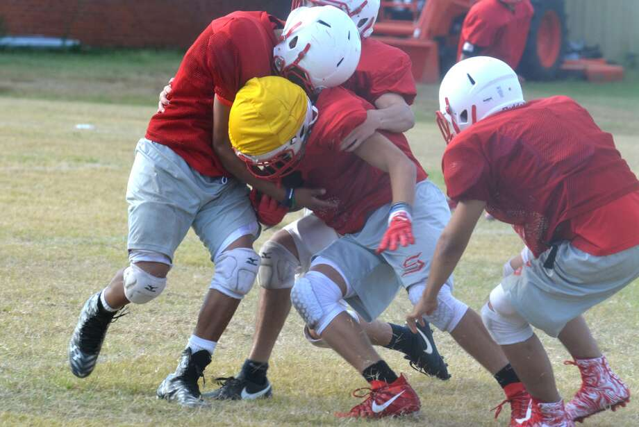 The Silverton football team has emphasized being physical this season, which has helped them win their first three games in dominant fashion. The attitude of physicality began before the season started, as illustrated in this photo of an early practice before the Owls had put on their full pads. Silverton will take on undefeated Lorenzo Friday night. Photo: Skip Leon/Plainview Herald