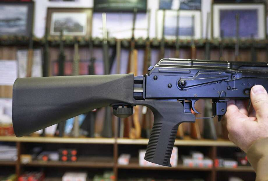 SALT LAKE CITY, UT - OCTOBER 5: A bump stock device (left) that fits on a semi-automatic rifle to increase the firing speed, making it similar to a fully automatic rifle, is installed on a AK-47 semi-automatic rifle, (right) at a gun store on October 5, 2017 in Salt Lake City, Utah. Congress is talking about banning this device after it was reported to of been used in the Las Vegas shootings on October 1, 2017.  (Photo by George Frey/Getty Images) Photo: George Frey, Stringer / Getty Images / 2017 Getty Images