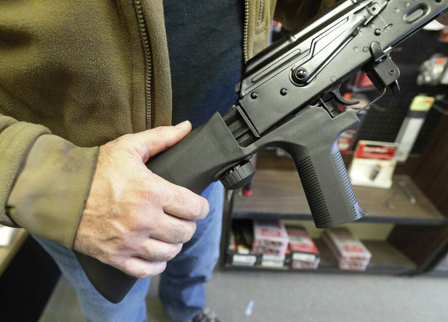 SALT LAKE CITY, UT - OCTOBER 5: A bump stock device, (left) that fits on a semi-automatic rifle to increase the firing speed, making it similar to a fully automatic rifle, is installed on a AK-47 semi-automatic rifle, (right) at a gun store on October 5, 2017 in Salt Lake City, Utah. Congress is talking about banning this device after it was reported to of been used in the Las Vegas shootings on October 1, 2017.  (Photo by George Frey/Getty Images) Photo: George Frey, Stringer / Getty Images / 2017 Getty Images